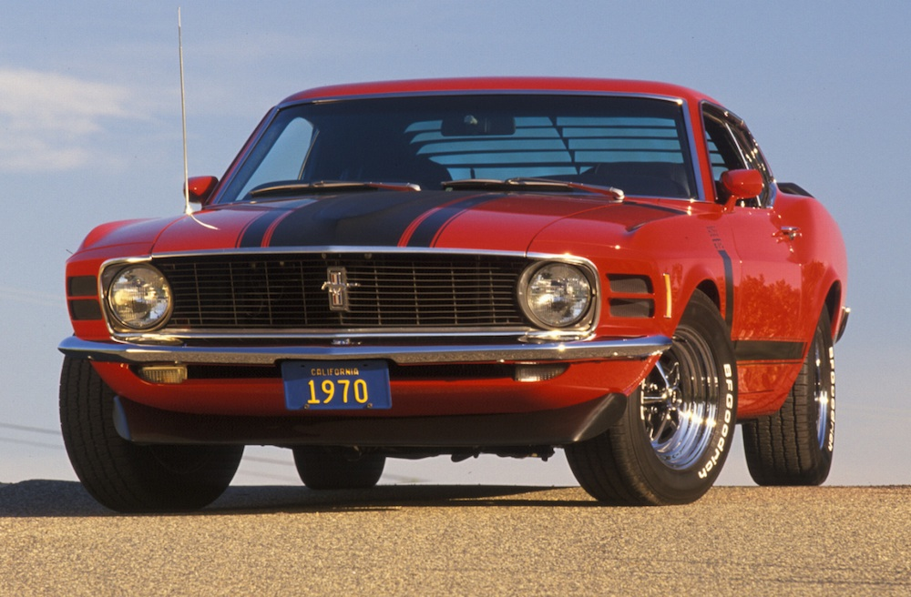 This is a set of ford promotional photos featuring a red for 1970 mustang rear window louvers